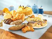 Bread and dessert arrangement on table — Stock Photo