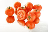 Cut tomato in wet group — Stock Photo
