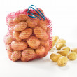 Sack of fresh potatoes on white background. — Stock Photo