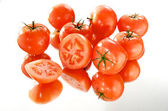 Tomatoes on white background, mirror — Stock Photo