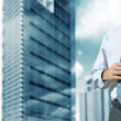 Office building and businessman — Stock Photo #5810735