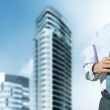 Office building and businessman — Stock Photo