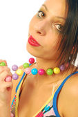 Beautiful girl with colorful necklace — Stock Photo