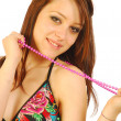 Beautiful girl in a bathing suit plays with a purple necklace — Stock Photo