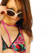 Beautiful girl plays with sunglasses — Stock Photo #6053855