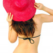 Beautiful sexy girl with a red straw hat — Stock Photo