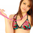 Girl in swimsuit playing with a necklace — Stock Photo