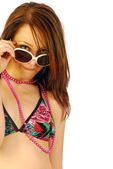 Beautiful girl plays with sunglasses — Stock Photo