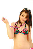 Girl in swimsuit with necklace — Stock Photo