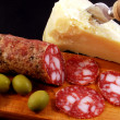 Grana cheese and salami — Stock Photo