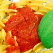 Stock Photo: Helical Fusilli with tomato sauce and basil