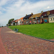 Homes on the seafront of Urk - Holland - Stock Photo
