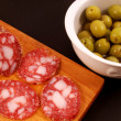 Sliced salami with olives - Stock Photo