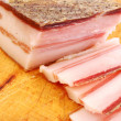 Slices of bacon on chopping board ready for cooking — Stock Photo #6062127
