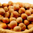 Stock Photo: Small basket of hazelnuts