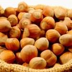 Small basket of hazelnuts — Stock Photo