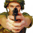 Stock Photo: Soldier threatened with gun
