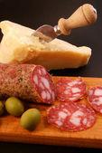 Grana and salami in the company — Stock Photo