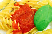 Helical Fusilli with tomato sauce and basil — Stock Photo