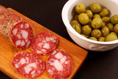 Sliced salami with olives — Stock Photo