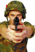 Soldier threatened with a gun — Stock Photo
