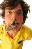 A boy eats a newspaper — Stock Photo