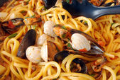 Fresh pasta with seafood — Stock Photo