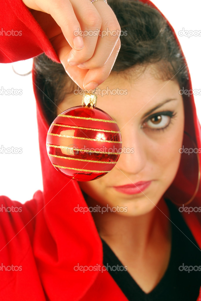 A young girl announces the arrival of Christmas with a Christmas colored ball — Stock Photo #6737859