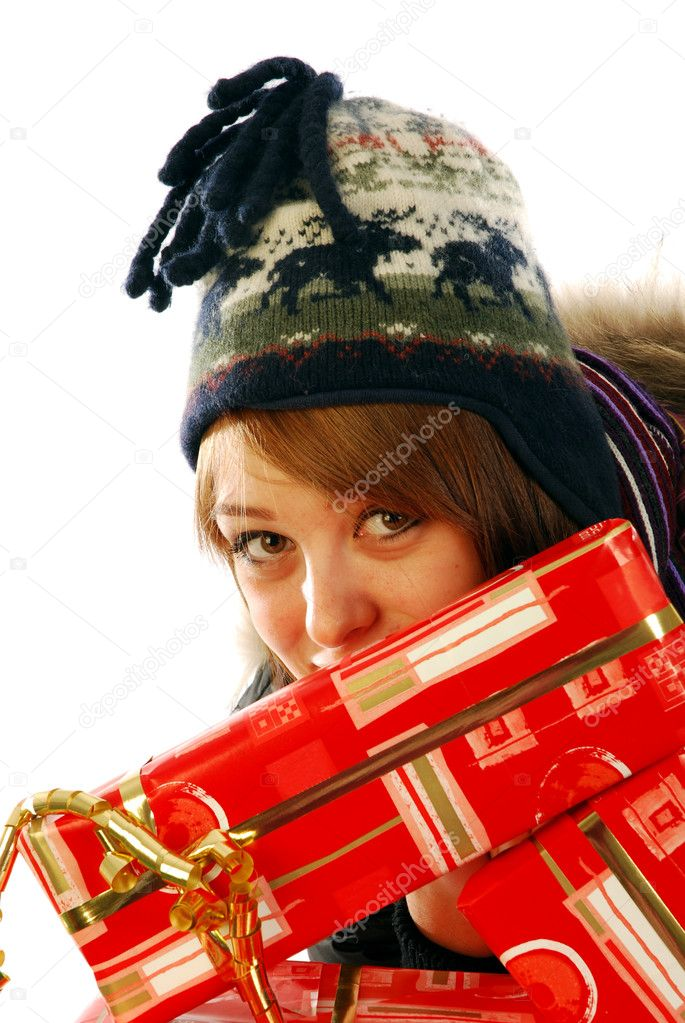 The happy look of a beautiful girl with Christmas gifts  Stock Photo #6737979