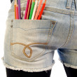 Jeans pocket with colored pencils — Stock Photo