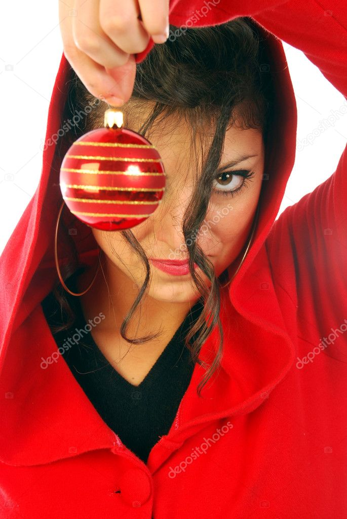 A young girl announces the arrival of Christmas with a Christmas colored ball — Stock Photo #6741107