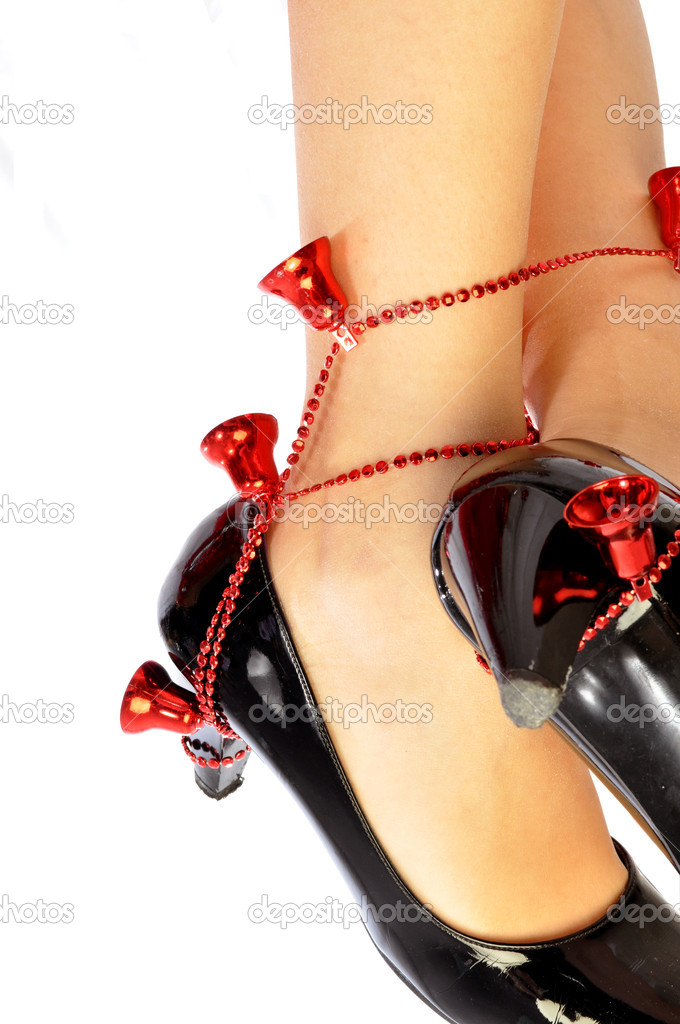 A woman with a pair of shoes decorated for Christmas  Stock Photo #6741203
