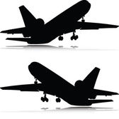 Airplane in black vector silhouettes — Stock Photo