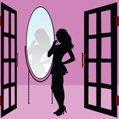 Hot and beautiful girl is looking in the mirror — Stock Photo