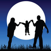 Happy family in the moonlight black silhouette — Stock Photo