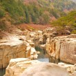 Ravine surrounded with huge rocks — Stock Photo #5840586