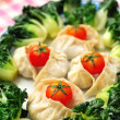 Chinese dumplings and vegetables — Stock Photo #5840633