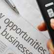 Closeup on new opportunities text and hand phone — Stock Photo #5840827
