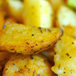 Stock Photo: Macro of seasoned potatos