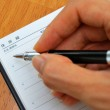 Hand writing with pen on Japanese address book — Stock Photo