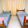 Twin beds in simple motel room — Stock Photo #5845545