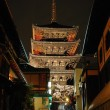 Night shot of five storied pagoda along an ancient street — Stock Photo