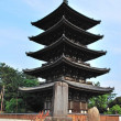 Deers flocking in front of majestic pagoda — Stock Photo #5846888