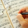 Writing on a music score — Stock Photo #5847027