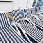 Row of beach chairs — Stock Photo #5847108