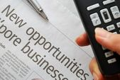 Closeup on new opportunities text and hand phone — Stock Photo