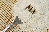 Fork in white rice — Zdjęcie stockowe