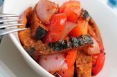 Sliced fish in spicy hot sauce — Stock Photo