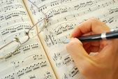 Writing on a music score — Stock Photo