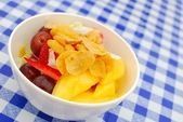 Healthy fruit salad topped with cereal — Stock Photo